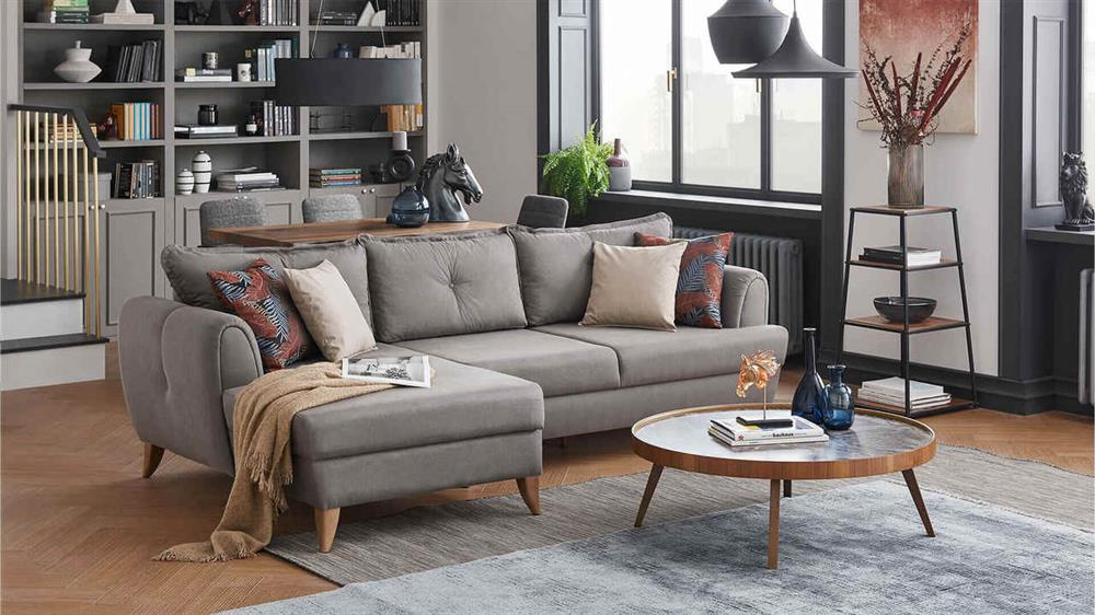 A beige colored sectional sofa